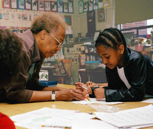 Experience Corps Member mentors a child with reading and other academic skills