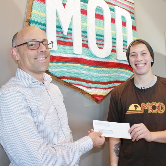 Matt Bartolotti Receives check from Mod Pizza