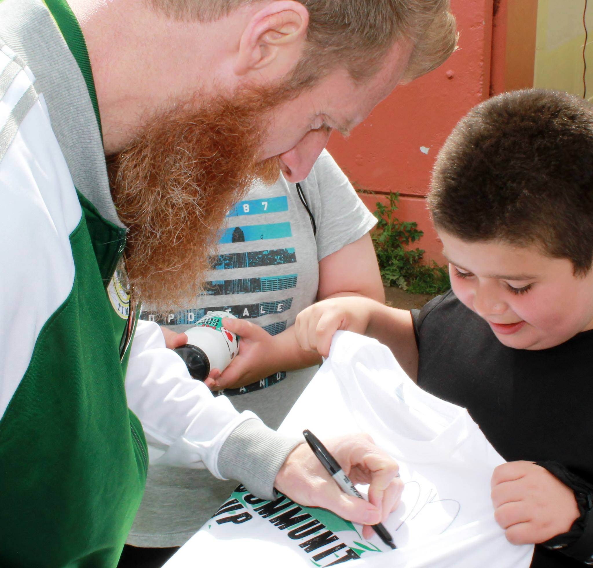 Community Cup - Nat Borchers of the Timbers signs autograph for Community Cup Player