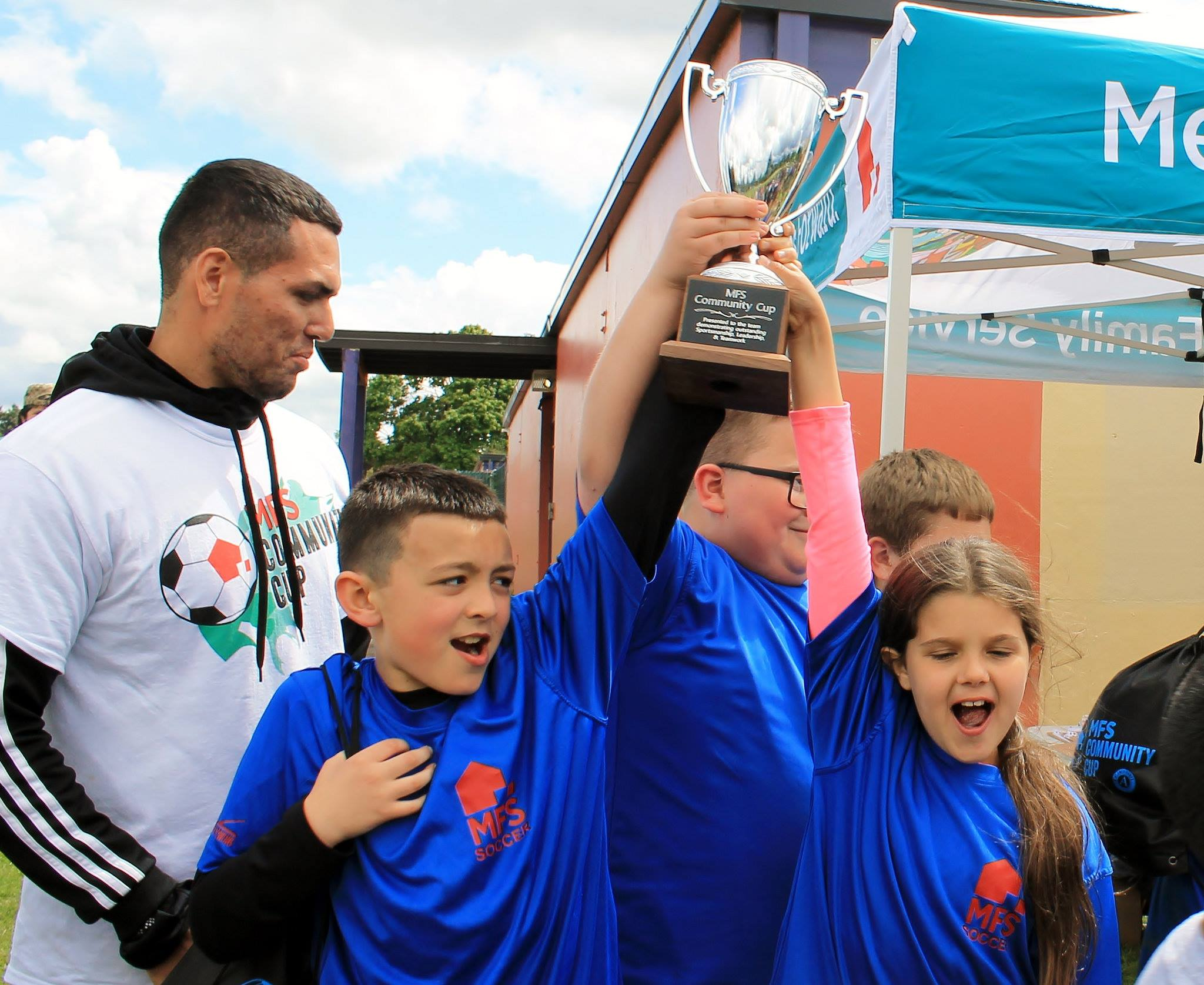 Community Cup - Holding up trophy